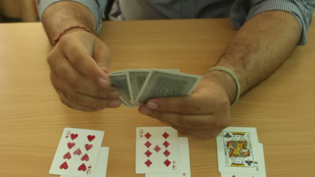 dealing cards on table - dealing cards stock videos and b-roll footage