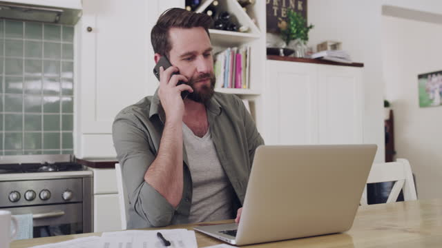 dealing with some work matters over the phone - life insurance stock videos & royalty-free footage