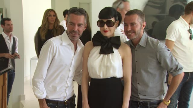 vídeos de stock, filmes e b-roll de dean dan caten dita von teese at the yooxcom and dsquared2 canine couture launch to benefit much love animal rescue at beverly hills ca - dita von teese