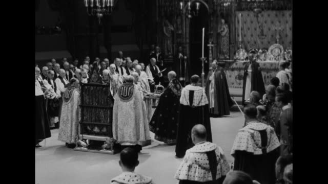 dean of westminster carrying st edward's crown on a cushion walks to archbishop of canterbury who takes it and holds it aloft over queen elizabeth ii... - cushion stock videos and b-roll footage