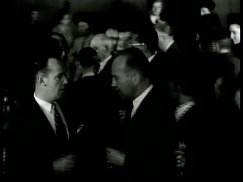 stockvideo's en b-roll-footage met dearing walking through crowd at cocktail party w/ man in suit stopping by stairs saying sot telling man he wouldn't advise him to make speech like... - avondjurk