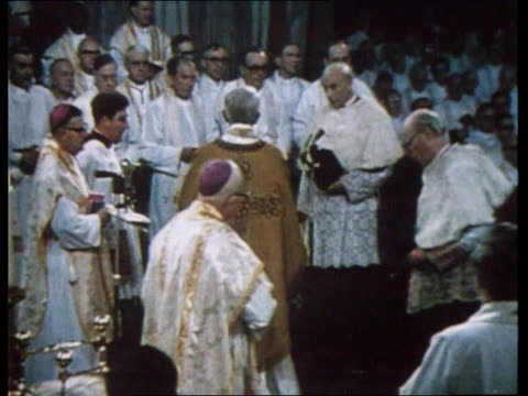 death announced lib england int cardinal basil hume along at service hume sat in chair reading ext hume along order ref bsp170699015 - cardinal clergy stock videos and b-roll footage