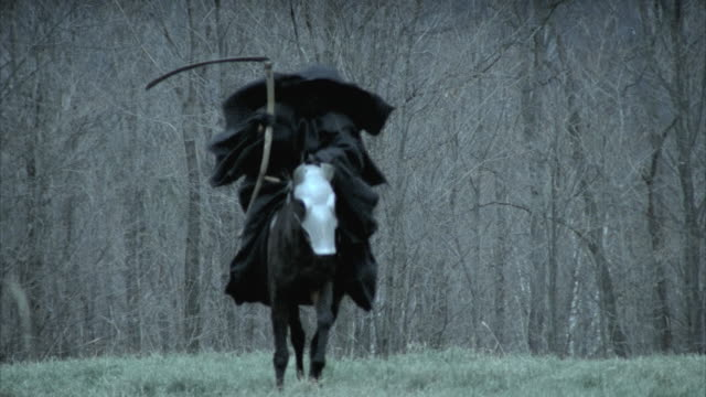 slo mo ms td pan cu death figure galloping on horseback through meadow, morrisville, vermont, usa - scythe stock videos and b-roll footage