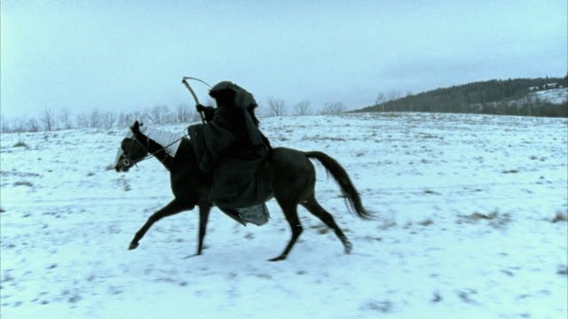 slo mo ms ts  death figure on horseback riding along woods, morrisville, vermont, usa - scythe stock videos and b-roll footage