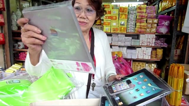 death is no barrier to chinese ancestors receiving the latest gadgets with paper ipads laptops and lcd tvs burned at gravesides across asia to mark... - liquid crystal display television stock videos and b-roll footage