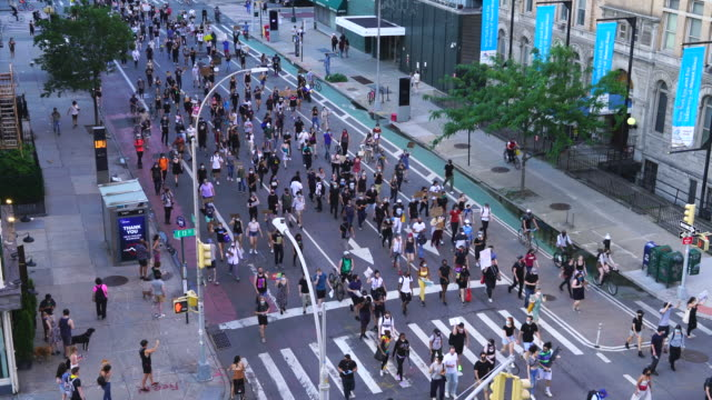 death of george floyd's protesters demonstrates peacefully on 2nd avenue around 14th street in the east village at new york city ny usa at 07:05 pm... - multiracial group stock videos & royalty-free footage