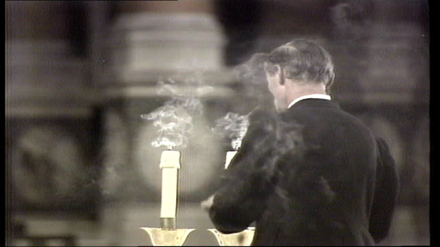 death of pope john paul i - requiem mass in westminster cathedral; bv man extinguishing candles - dissolve - pope john paul ii stock videos & royalty-free footage