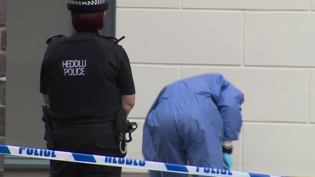 Death of soldier on edge of Brecon Beacons WALES Brecon EXT Police incident tent and tape at scene of murder Forensic officer along Tent and forensic...