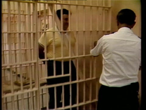 look at florida state prison usa florida state prison ext prison fence zoom windows man to entrance tilt up prison suchet in front of electric chair... - florida us state stock videos and b-roll footage
