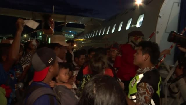 Death toll estimate from Sulawesi earthquake and tsunami rises to 1300 Palu Indonesia various of people at airport fleeing after earthquake Sulawesi...