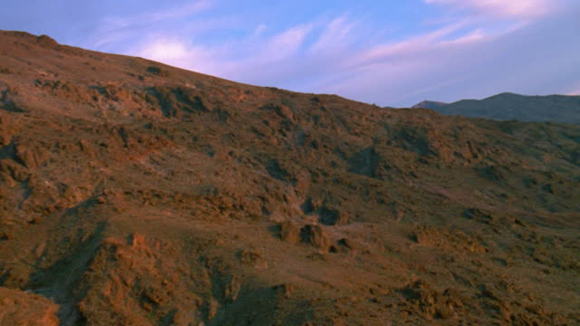 death valley national park aerial fly-over of zabriskie point manly beacon - zabriskie point stock videos & royalty-free footage