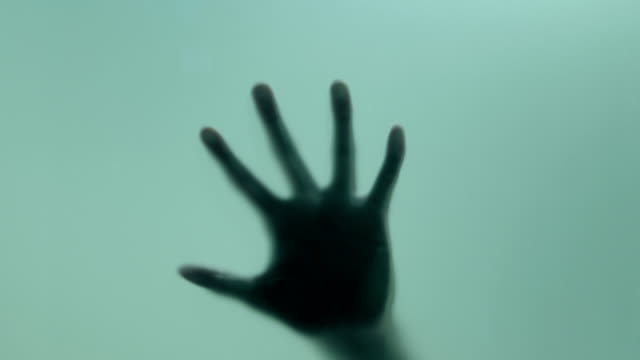 death,murderer,illness......spooky hand - trapped stock videos & royalty-free footage