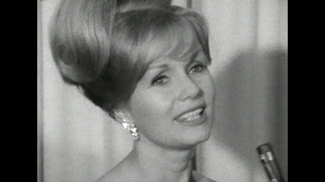 debbie reynolds - interview - does she like to film in other countries - peter ustinov stock videos & royalty-free footage