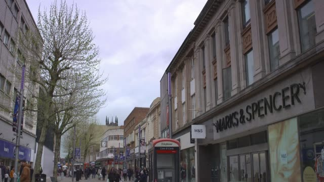 debenhams announces closure of 22 stores england west midlands wolverhampton ext people along shopping street row of shops including marks spencer... - west midlands stock-videos und b-roll-filmmaterial
