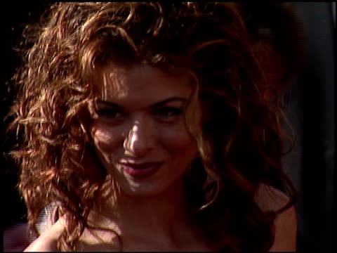Debra Messing at the 1999 Emmy Awards at the Shrine Auditorium in Los Angeles California on September 12 1999
