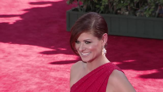 Debra Messing at the 61st Annual Primetime Emmy Awards Arrivals Part 2 at Los Angeles CA