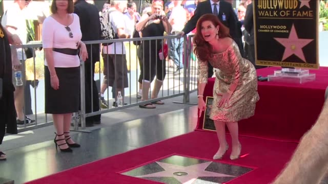 debra messing now has her own star on hollywood boulevard the will and grace actress unveiled friday her walk of fame star in los angeles - debra messing stock videos and b-roll footage