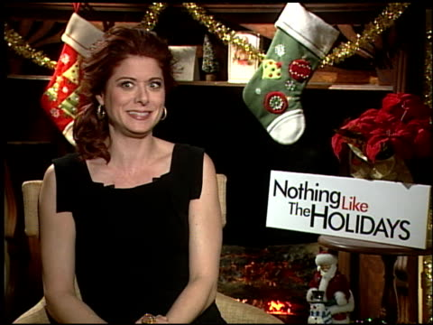 debra messing on if the cast mates were surprised by her dancing at the 'nothing like the holidays' junket at los angeles ca - debra messing stock-videos und b-roll-filmmaterial