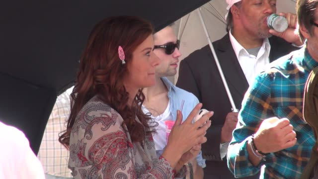 debra messing on location for 'smash' in times square in new york ny on 09/12/12 - debra messing stock-videos und b-roll-filmmaterial