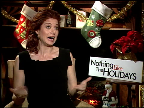 debra messing on the dancing sequences in the film at the 'nothing like the holidays' junket at los angeles ca - debra messing stock-videos und b-roll-filmmaterial