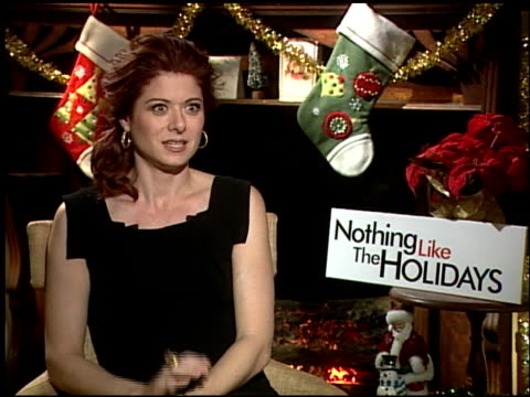 debra messing on the experiences filming in chicago and humboldt park at the 'nothing like the holidays' junket at los angeles ca - debra messing stock-videos und b-roll-filmmaterial