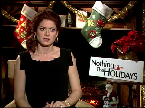 debra messing on the experiences working with him at the 'nothing like the holidays' junket at los angeles ca - debra messing stock-videos und b-roll-filmmaterial