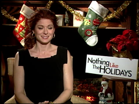debra messing on working with freddie rodriquez at the 'nothing like the holidays' junket at los angeles ca - debra messing stock-videos und b-roll-filmmaterial