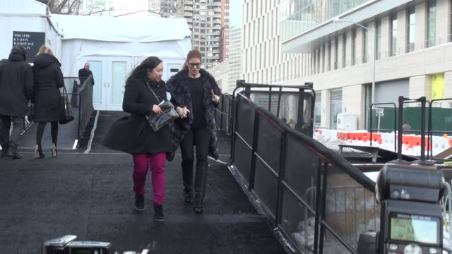 debra messing poses for photographers after leaving the dennis basso show at the mercedesbenz fashion week fall 2014 at lincoln center celebrity... - debra messing stock-videos und b-roll-filmmaterial