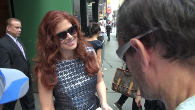 Debra Messing signs for and poses with fans outside of Good Afternoon America in New York 08/22/12