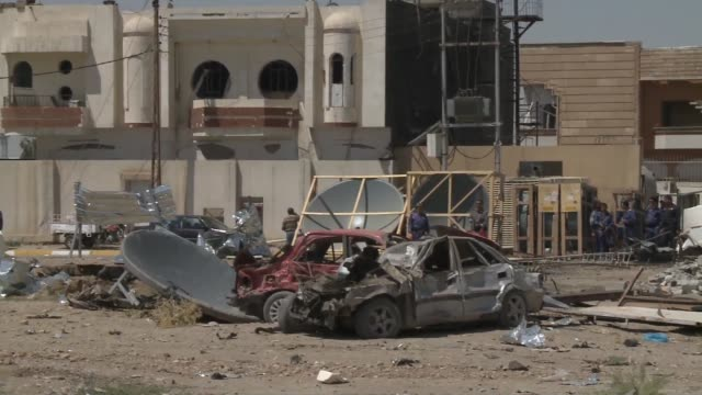Debris and mangled cars seen in Kirkuk following suicide bombing