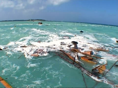 MS debris caused by tsunami damage floating in rough sea coming inland, Thailand