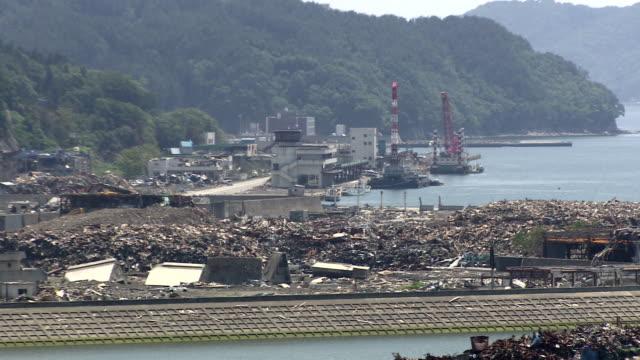 Debris covers a shoreline.