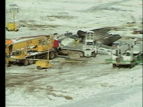 debris covers the runway from the mcdonnell-douglas continental dc-9 jet plane crash at stapleton international airport. - stapleton stock videos & royalty-free footage