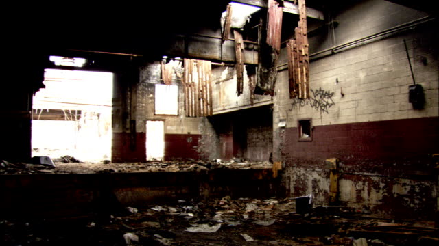 Debris fills a derelict warehouse. Available in HD.
