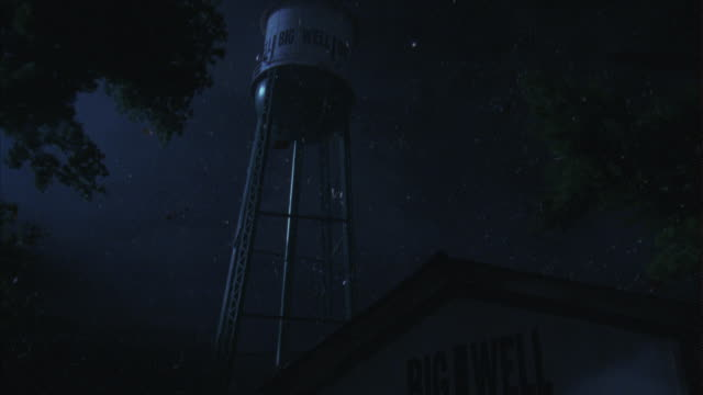 debris flies through the air near a water tower during a tornado. - blowhole stock videos & royalty-free footage