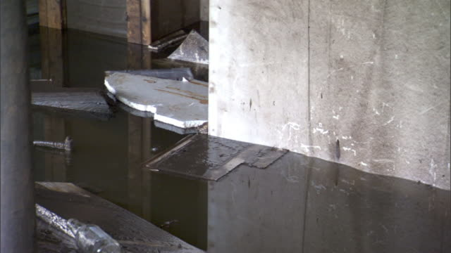 Debris floats in the basement of a flood damaged building.