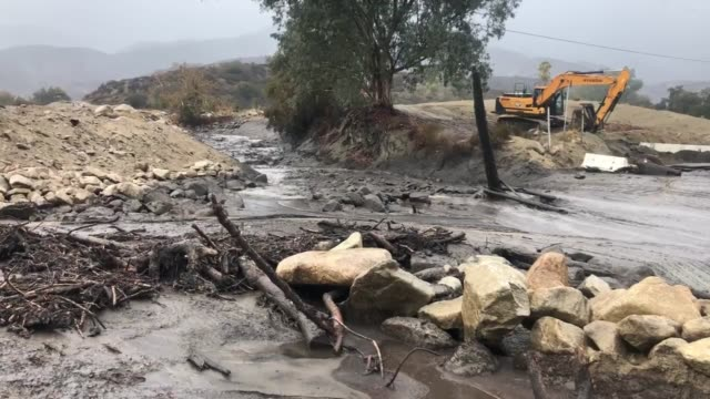 Debris flow rages down Horsethief Canyon north of Lake Elsinore in Holy Fire burn scar area