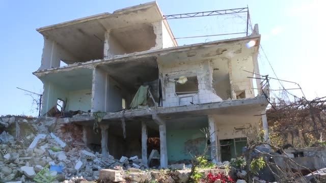 debris of buildings are seen after russian airstrikes at bayirbucak turkmen region in latakia syria on november 22 2015 - syria stock videos & royalty-free footage