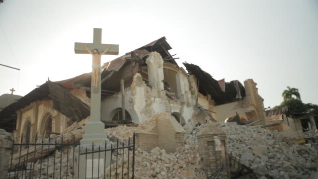 debris of foundation at the bottom of a church destroyed by the haiti earthquake of january 2010 - ポルトープランス点の映像素材/bロール