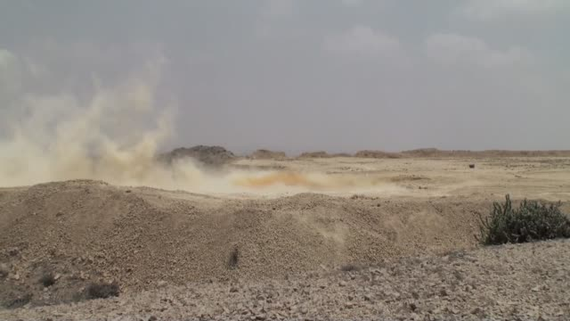 debris rises from the blasting of limestone at a quarry supplying materials to the power cement ltd plant operated by arif habib group in nooriabad... - 石切場点の映像素材/bロール