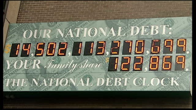 democrats and republicans cannot reach agreement; ext us national debt clock close shot of national debt clock mid shot of capitol building - national debt clock stock videos & royalty-free footage