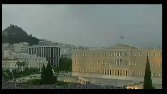IMF bailout due to expire GREECE Athens EXT Lightning strike above Parliament building and crowds of protesters outside
