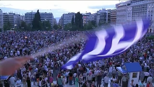 no deal reached on imf loan; greece: athens: ext / dusk low angle view of protesters with european union flags at pro-eu demonstration outside greek... - greece stock videos & royalty-free footage