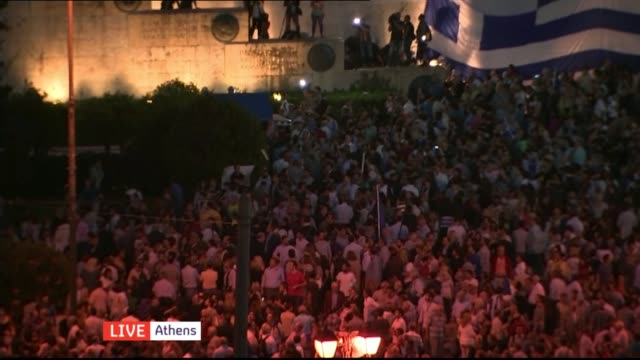 talks continue on bailout funds greece athens anna michele asimakopoulou live interview sot cutaways protesters at demonstration in syntagma square... - 緊急援助点の映像素材/bロール