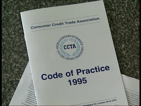 debt problems on the increase seq man sitting in debt counselling session consumer credit trade association code of practice document on table... - card table stock videos & royalty-free footage