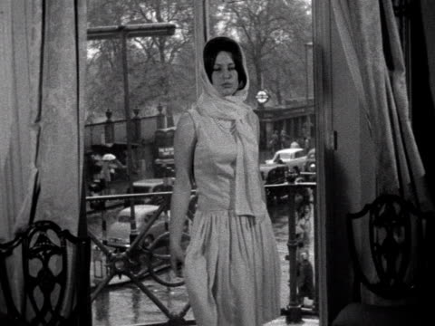 a debutante models a silk dress and scarf 1961 - debutante stock videos & royalty-free footage