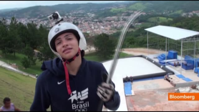 dec. 5 on a recent training day at a dry slope ski park outside brazils biggest city, sao paulo, lais da silva souza clips on ski boots and skis... - größter stock-videos und b-roll-filmmaterial