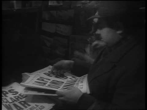 "dec. 7 1941 man buying evening newspaper reading ""japs bomb hawaii"" / newsreel - western script stock videos & royalty-free footage"