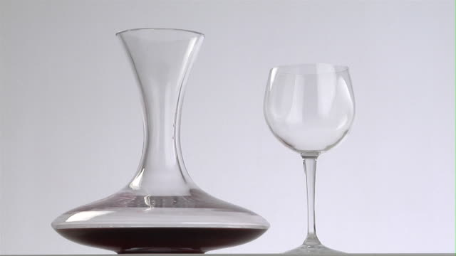 cu, decanter with red wine and empty wine glass - decanter stock videos & royalty-free footage