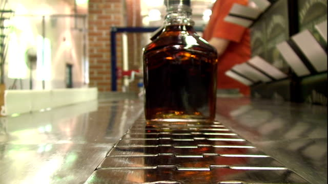 decanters of whiskey move on a conveyor toward the shipping department. - decanter stock videos & royalty-free footage